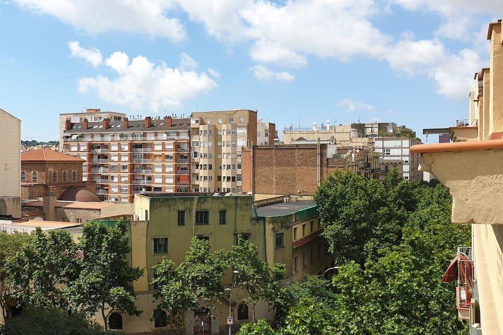 Tweepersoonskamer, gemeenschappelijke badkamer - Uitzicht op stad