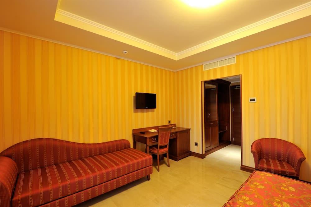 Apartmá s ložnicí a obývacím koutem, vedlejší budova - Obývací pokoj