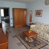 Chambre Triple - Salle de séjour