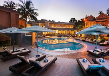 Picture of Whispering Palms Beach Resort in Candolim