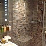 Huoneisto, Makuuhuoneen yhteydessä oleva kylpyhuone (Garden Suite 1) - Kylpyhuone