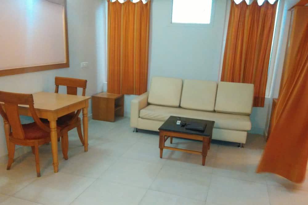 Prabangaus stiliaus vienvietis kambarys - Svetainės zona