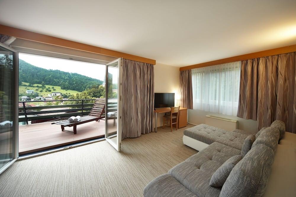 Suite, 1 chambre, salle de bains privée, vue parc - Salle de séjour