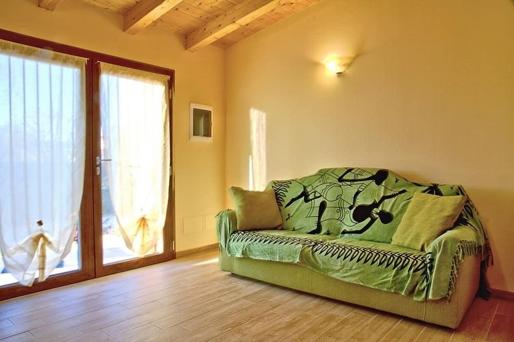 Departamento, 2 habitaciones, vista al jardín - Sala de estar