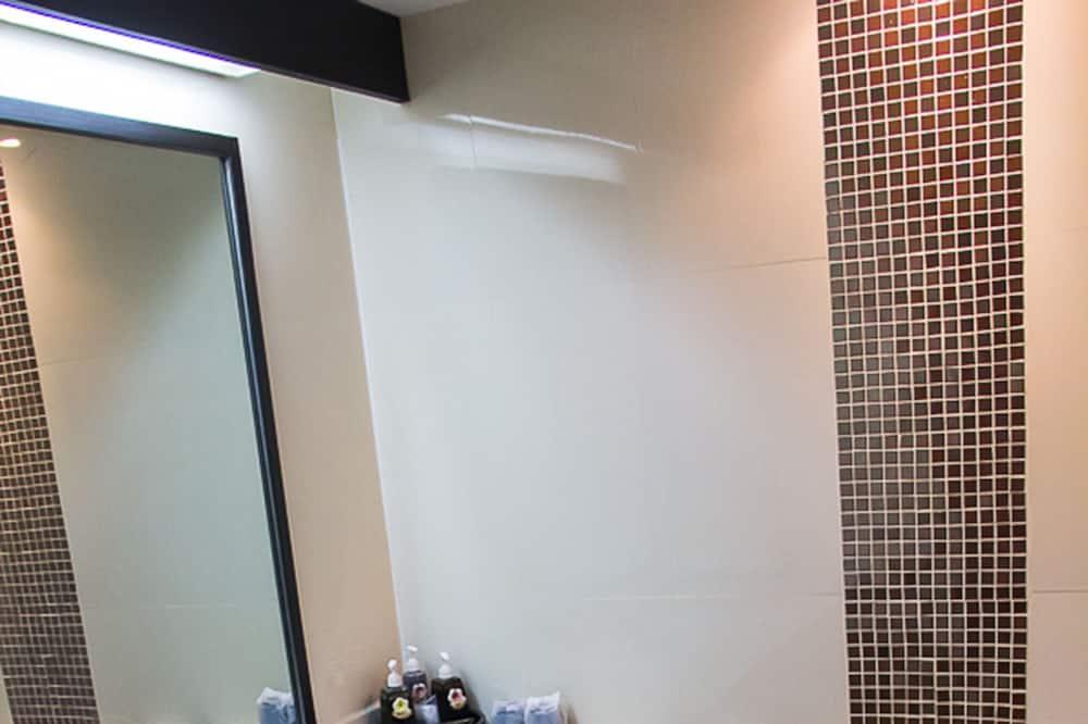 Grand Inn Suite Bedroom - Bathroom