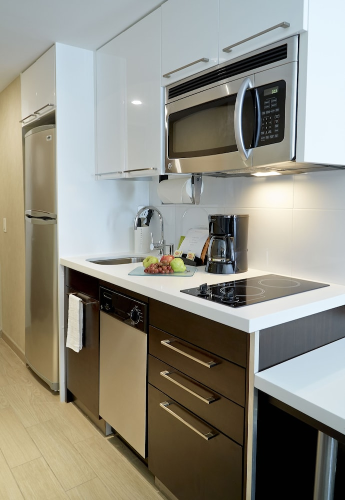 Book staybridge suites times square in new york hotels staybridge suites times square new york standard studio suite kitchen in workwithnaturefo