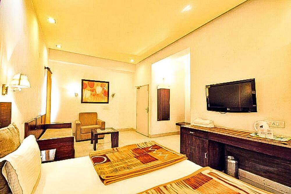 Prémium szoba kétszemélyes ággyal, kilátással a városra - Nappali