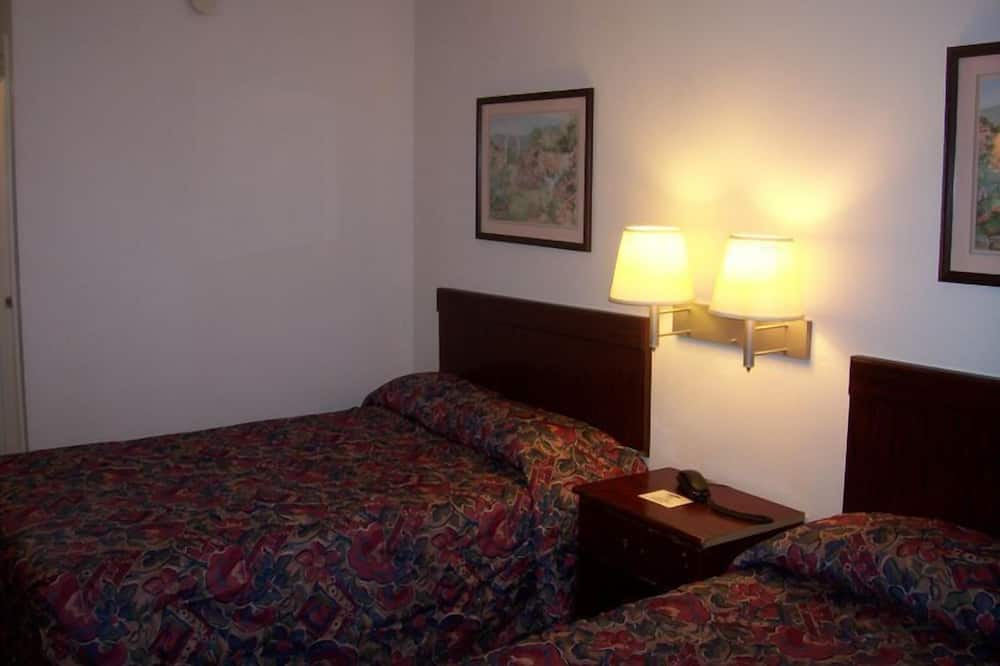 Standard room with two double beds - Guest Room