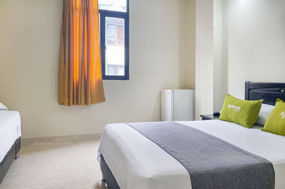 Habitación triple estándar - Sala de estar