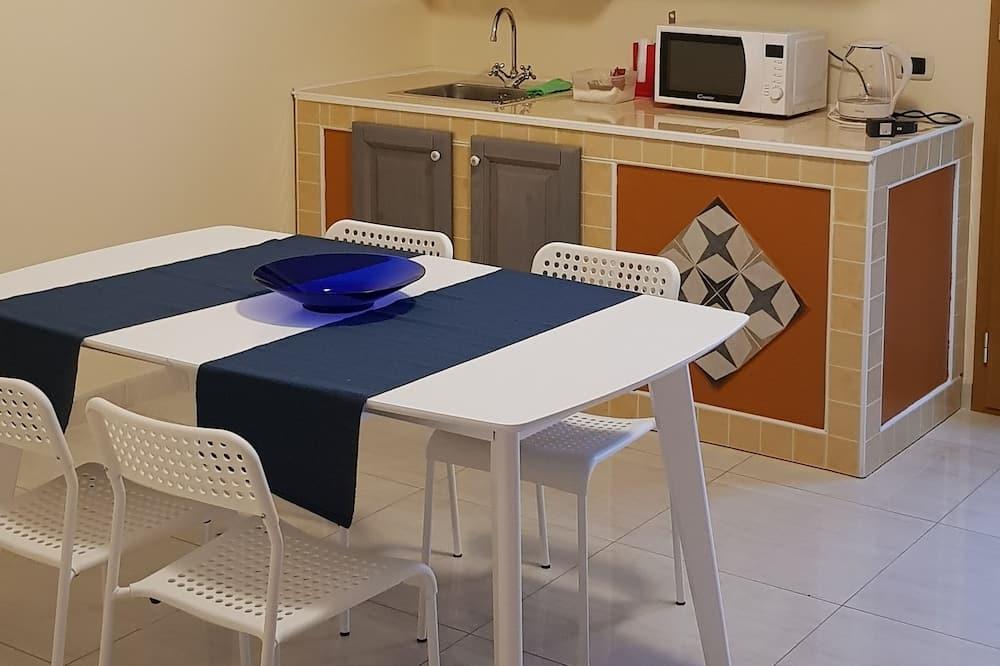 Obiteljska četverokrevetna soba (Green Orchid) - Zajednička kuhinja