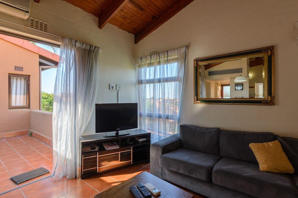 Family Triple Room - Living Room