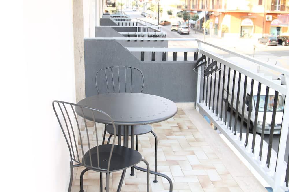 Pokoj Comfort s dvojlůžkem nebo dvěma jednolůžky, nekuřácký - Balkón