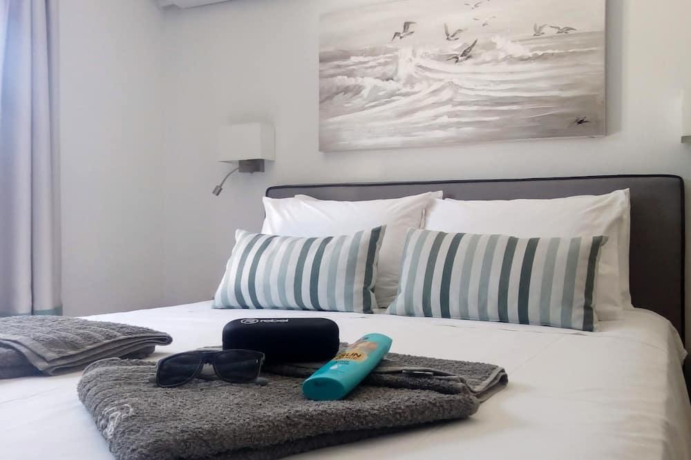 Comfort-Suite, 1Queen-Bett und Schlafsofa - Zimmer