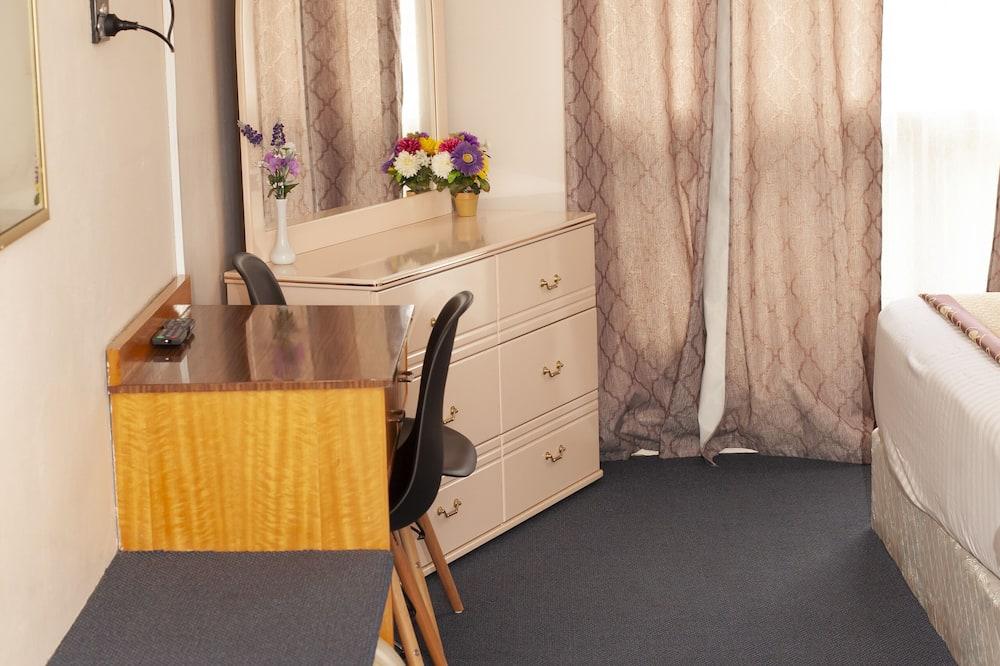 Kambarys šeimai, 1 miegamasis - Svetainės zona