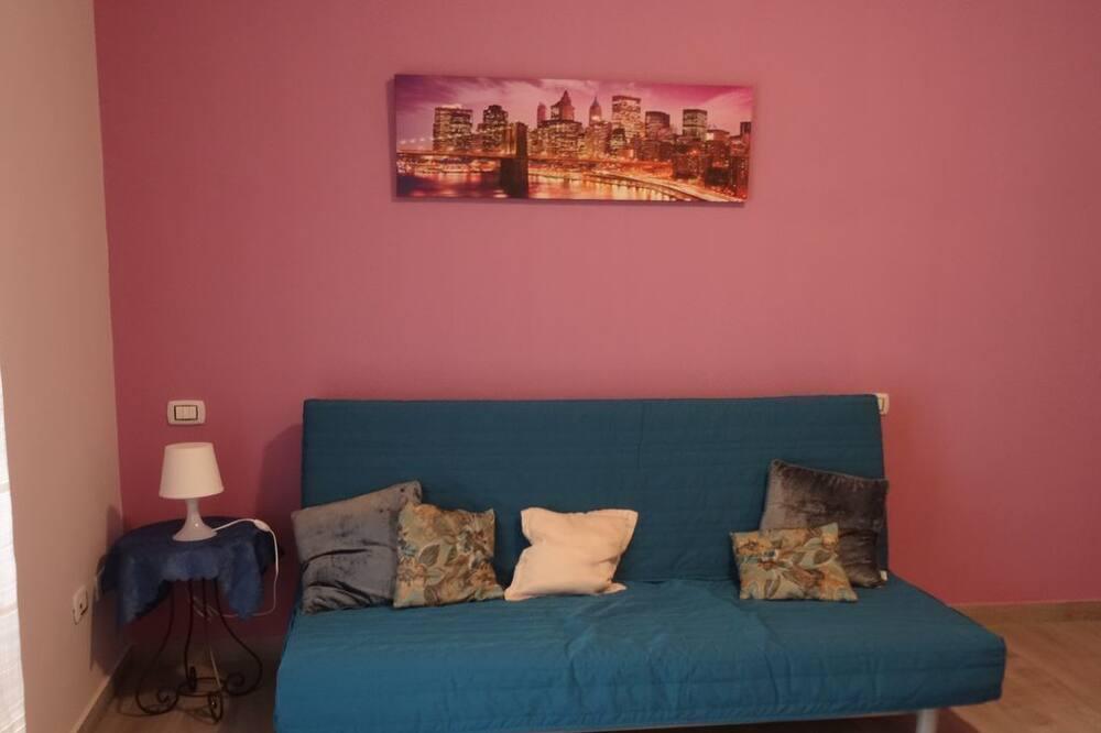 Eenvoudig appartement - Woonkamer