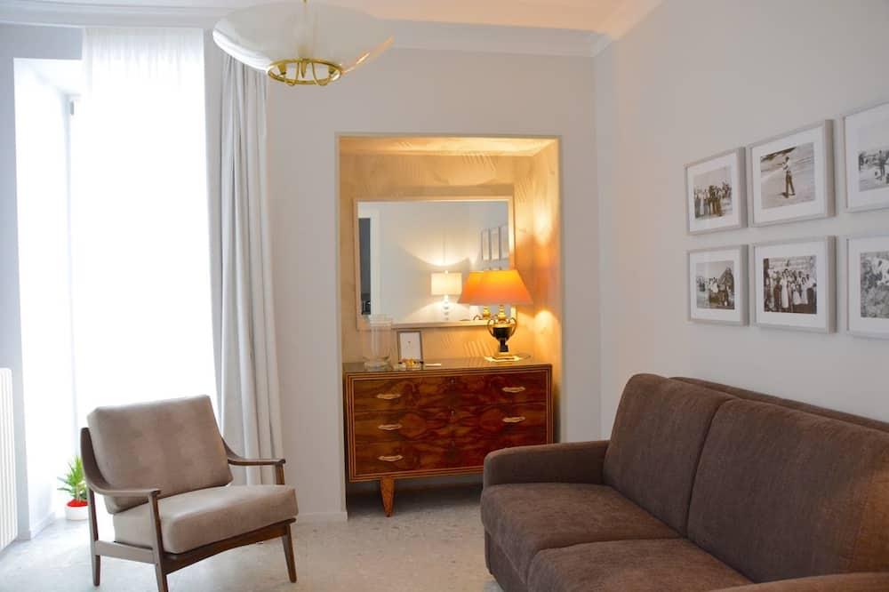 Habitación cuádruple Deluxe - Zona de estar