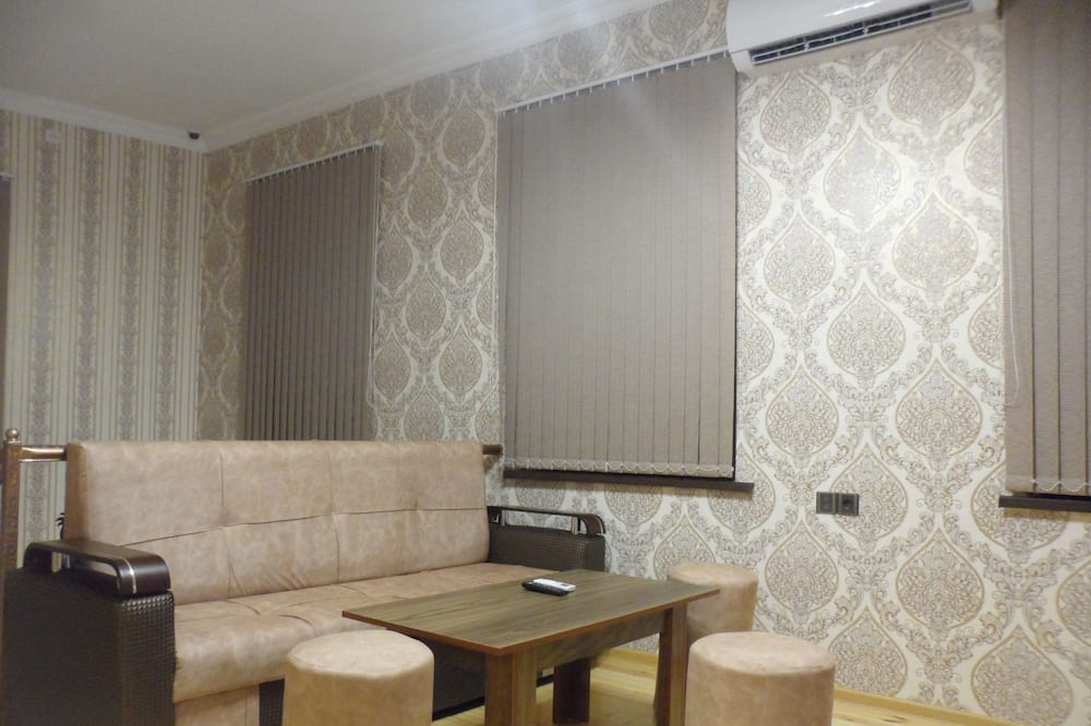 Kamar Quadruple Comfort - Ruang Keluarga