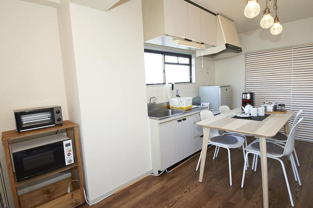 Appartement (Apartment Room 701) - Eetruimte in kamer