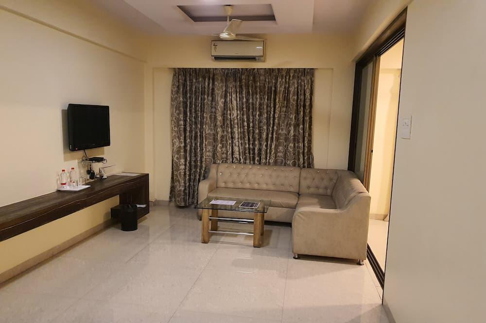 Familie suite, 1 slaapkamer, niet-roken, Uitzicht op de stad - Woonruimte