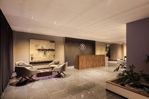 哈爾瑪套房酒店/