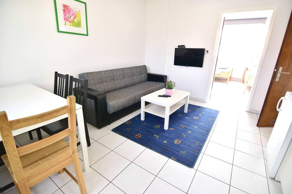 شقة - غرفة نوم واحدة (HR100-K28) - منطقة المعيشة