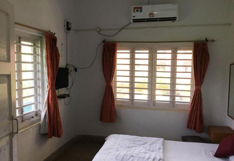 Aruni Guest House, Puri, Zimmer