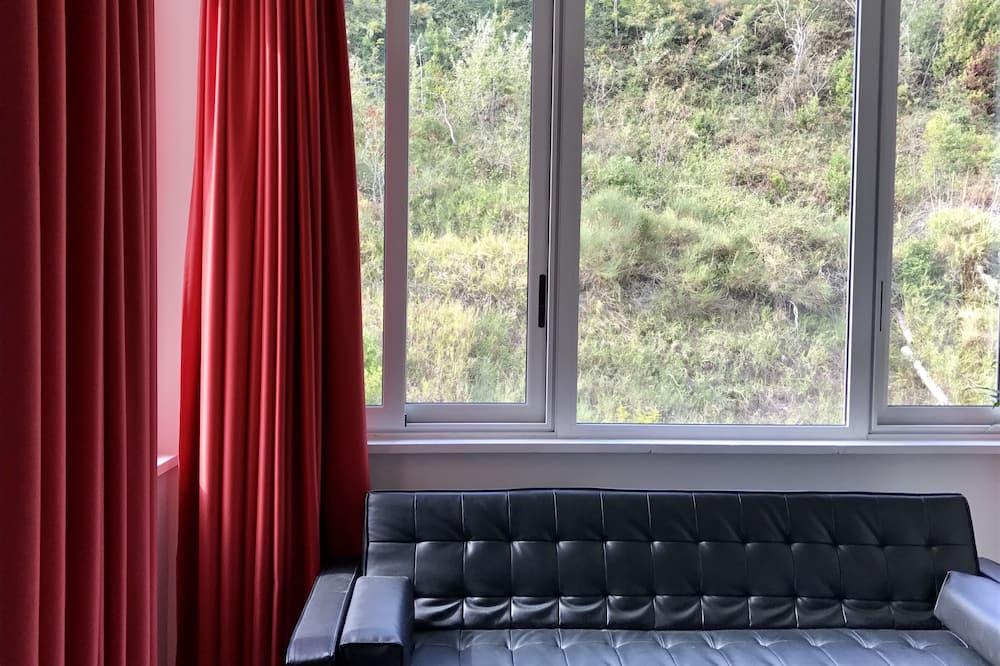 חדר מעוצב זוגי, מיטת קווין, ללא עישון - אזור מגורים