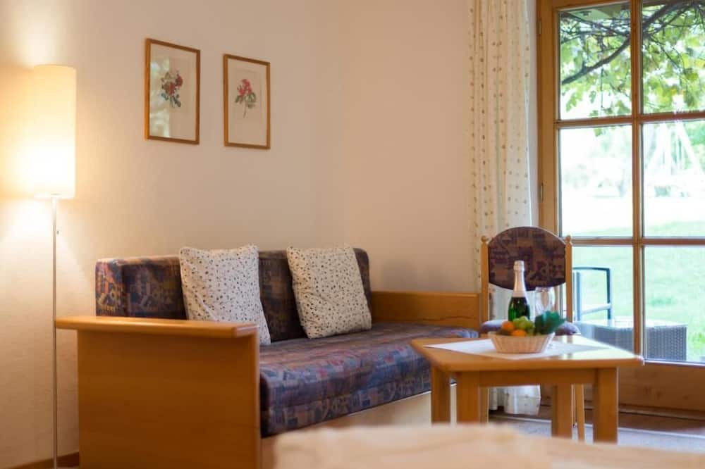 スタンダード アパートメント キングベッド 1 台 簡易キッチン - リビング エリア