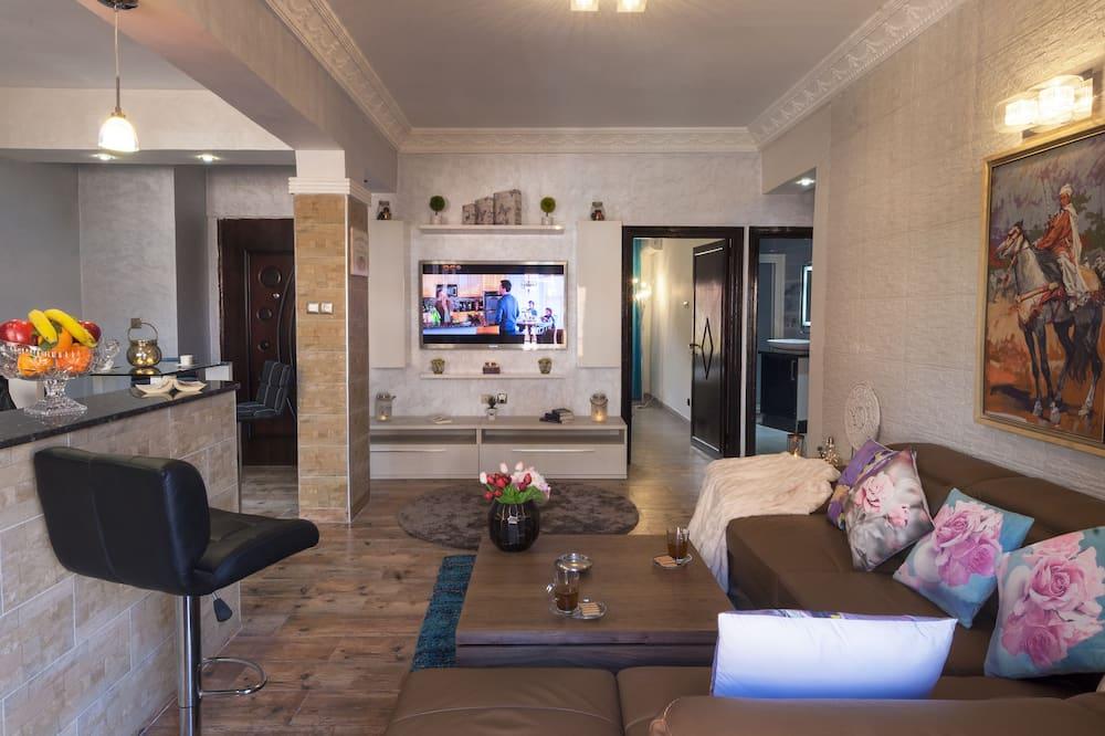 شقة في المدينة - غرفتا نوم - منطقة المعيشة