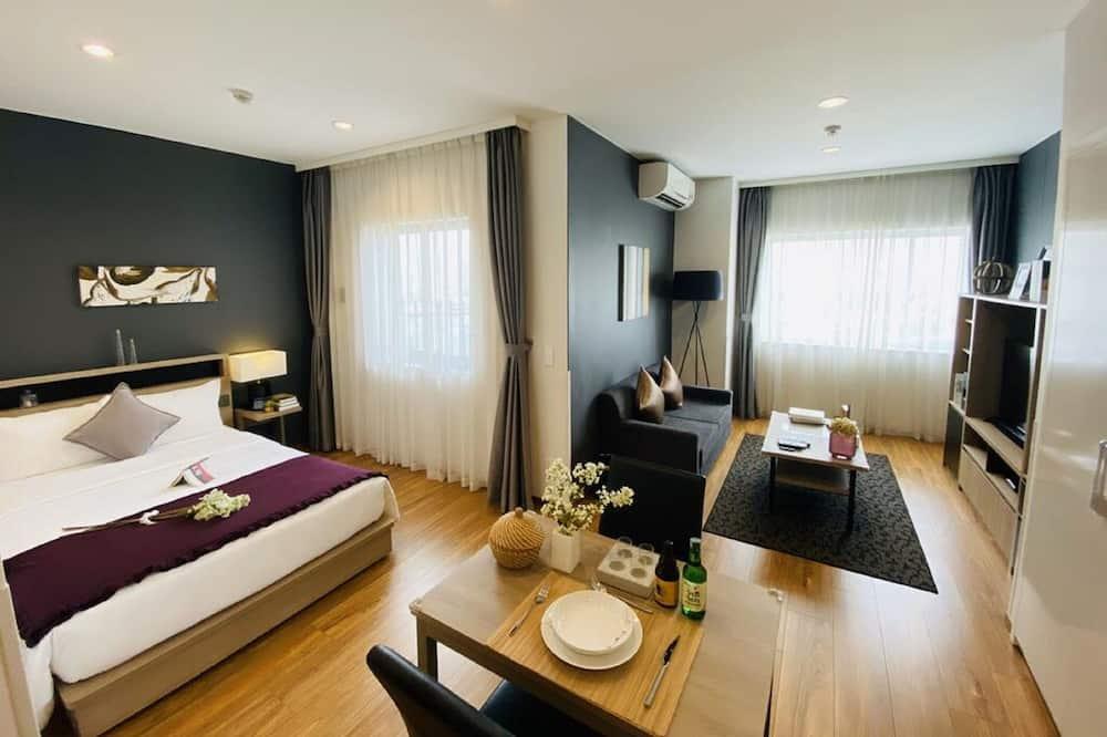 Habitación superior, 1 cama Queen size (Residential) - Servicio de comidas en la habitación