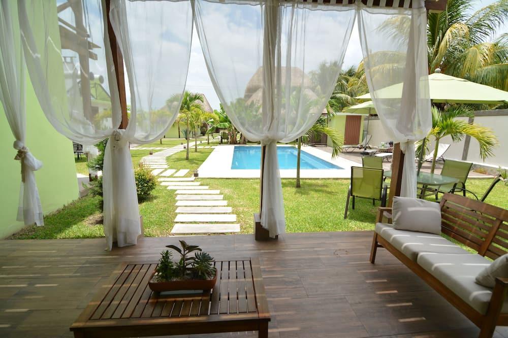 Habitación cuádruple exclusiva, 2 camas dobles, para no fumadores - Sala de estar