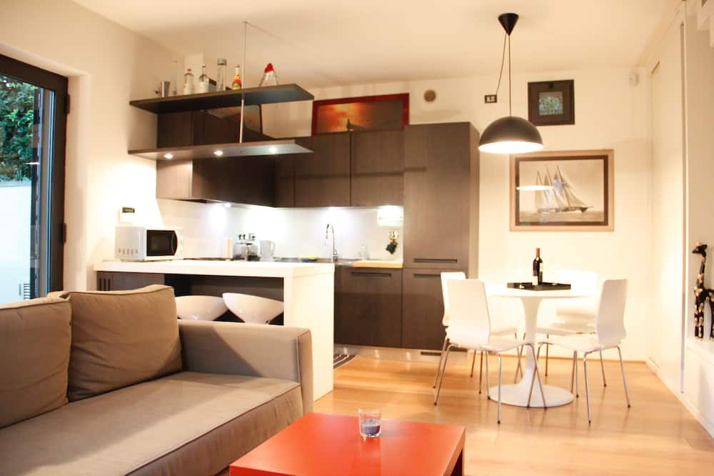 Appartement Duplex, terrasse, vue jardin - Coin séjour
