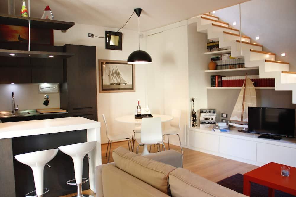 Appartement Duplex, terrasse, vue jardin - Salle de séjour