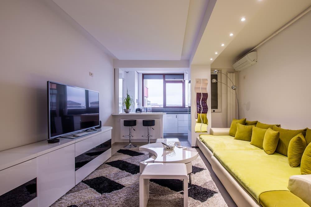 Luxe appartement, 1 queensize bed met slaapbank, Toegankelijk voor mindervaliden - Woonkamer