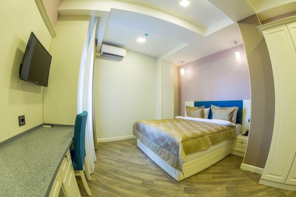 Ekonomiskās klases divvietīgs numurs ar divguļamo gultu, 1 vienguļamā gulta, stūris - Dzīvojamā istaba