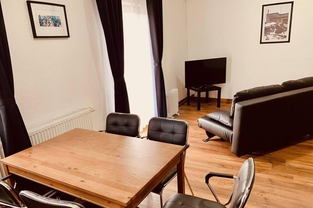 Camera familiare, 1 letto queen con divano letto, non fumatori - Area soggiorno
