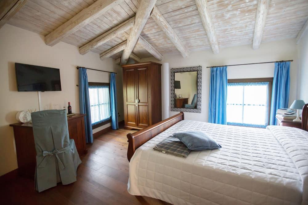 Suite – junior, 1 queensize-seng med sovesofa, ikke-røyk, utsikt mot hage - Utvalgt bilde