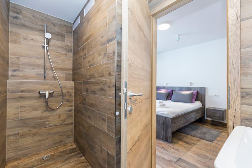 Izba typu Deluxe s dvojlôžkom alebo oddelenými lôžkami, výhľad na mesto - Kúpeľňa