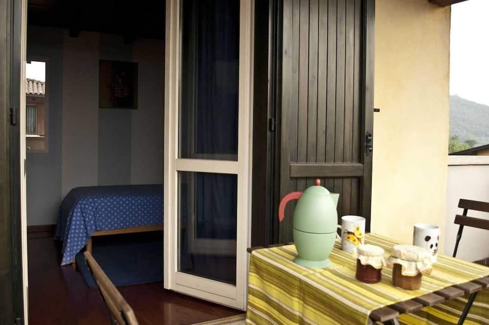 Comfort driepersoonskamer, uitzicht op tuin - Balkon