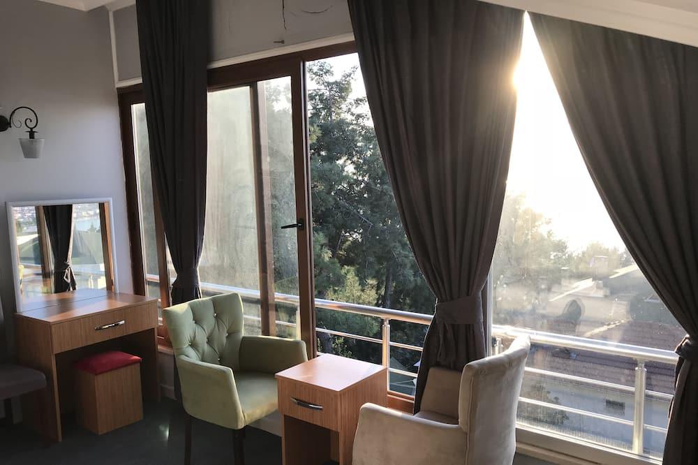 Familienzimmer, Meerblick - Wohnbereich