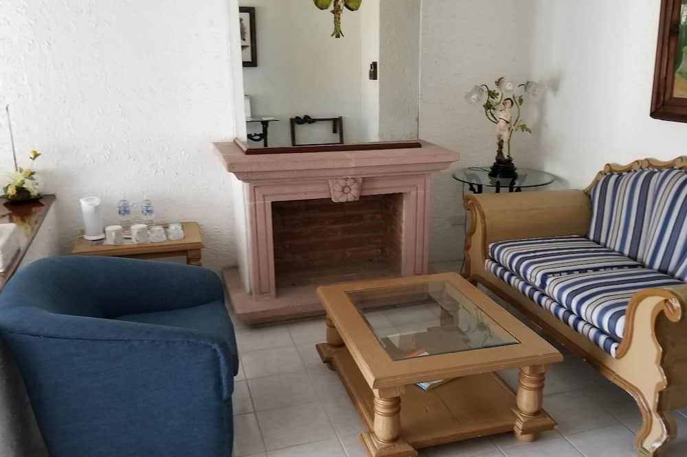 חדר סטנדרט לארבעה, 2 מיטות זוגיות, נוף לגן - סלון