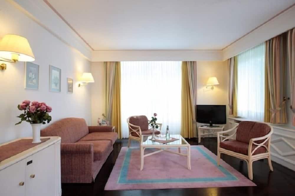 Luxe suite, 1 slaapkamer, niet-roken, bubbelbad - Woonruimte