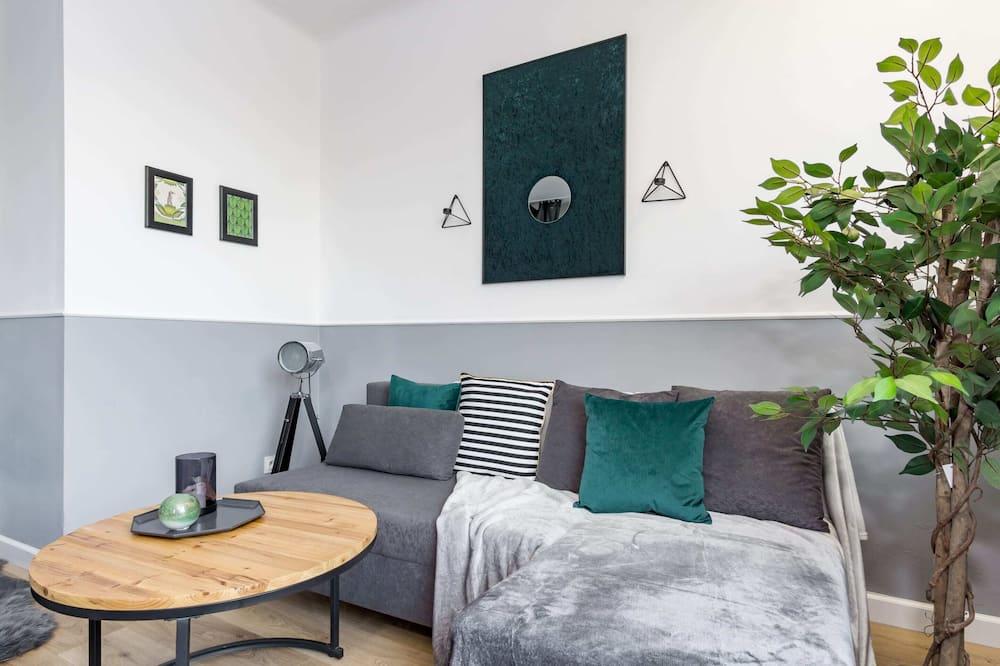 Komforta studijas tipa luksusa numurs, 1 divguļamā gulta un dīvāngulta, skats uz pilsētu - Dzīvojamā istaba