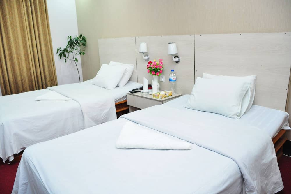 ห้องดีลักซ์ดับเบิลหรือทวิน, เตียงเดี่ยว 2 เตียง, พร้อมสิ่งอำนวยความสะดวกสำหรับผู้พิการ, สูบบุหรี่ได้ - ห้องพัก