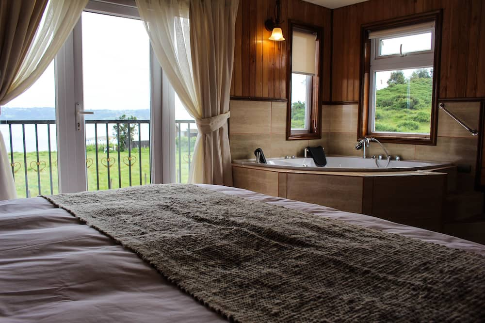 Habitación Deluxe doble, 1 cama de matrimonio grande, bañera de hidromasaje, vistas a la bahía - Habitación