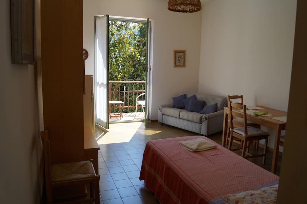 Апартаменты базового типа, 1 спальня, мини-кухня, первый этаж - Зона гостиной