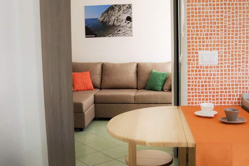 Třílůžkový pokoj (nuvola) - Obývací prostor
