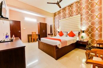 Foto van OYO 18938 Hotel Mars in Ernakulam