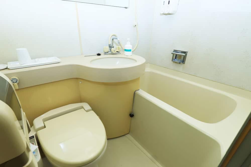エコノミー ダブルルーム セミダブルベッド 1 台 喫煙可 - バスルームの設備