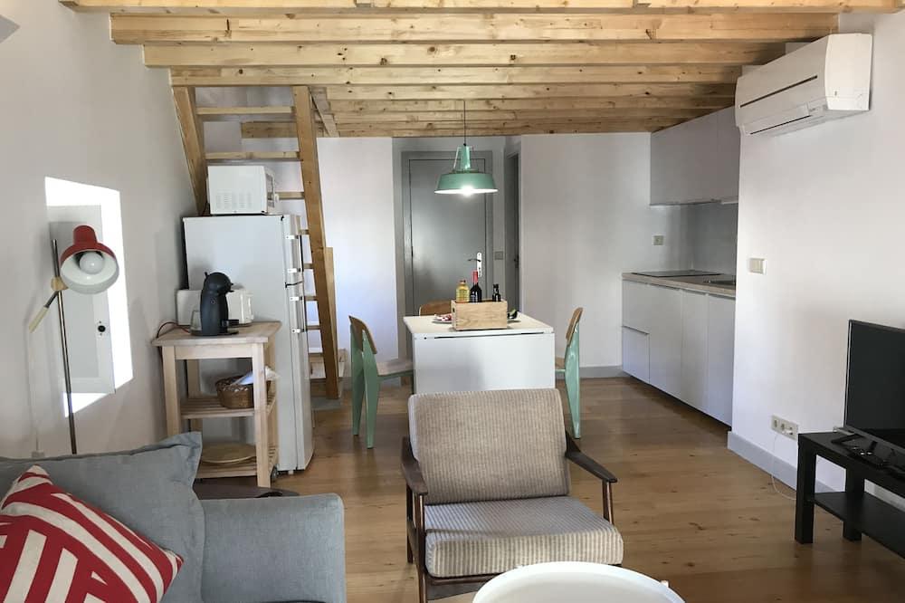 Dvoupodlažní apartmá, v mezaninu (4D) - Obývací prostor